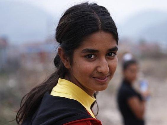 Junge Frau auf der Flucht-Foto Caritas.jpeg